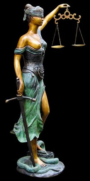 Saraland Alabama statue of lady justice balancing scales