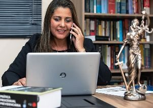 Anchorage Alaska female paralegal consulting with client on phone
